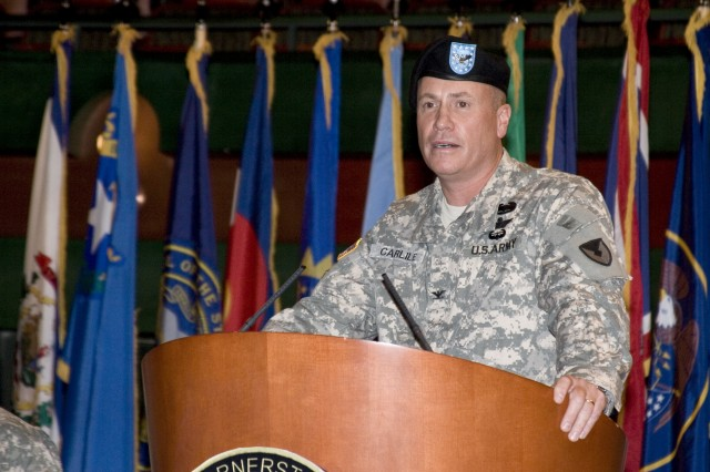 Corpus Christi, TX: After receiving Command of the Corpus Christi Army Depot, new commander, Col. Christopher B. Carlile addresses depot employees at the Texas A&M university Performing Arts Center, June 2, 2010. (RELEASED)