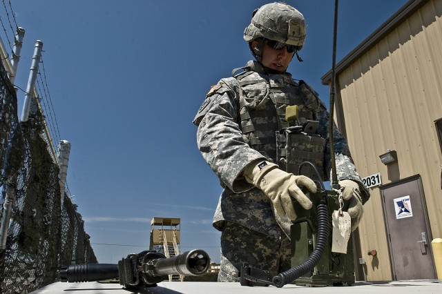 FORT HOOD, Texas-Wharton, Texas native, Sgt. Timothy Long, a shop foreman with the 2nd battalion, 20th Field Artillery Regiment, 41st Fires Brigade, assembles a field radio to perform a communication check during the 1st Cavalry Division Non Commissioned Officer and Soldier of the Year competition, June 1.