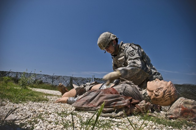 FORT HOOD, Texas-Wharton, Texas native, Sgt. Timothy Long, a shop foreman with the 2nd battalion, 20th Field Artillery Regiment, 41st Fires Brigade, removes the flack vest from a simulated casualty during the 1st Cavalry Division, Non Commissioned Officer and Soldier of the Year competition, June 1. Competitors are evaluated on how quickly and efficiently they apply combat lifesaver skills to prepare the casualty for medical evacuation.