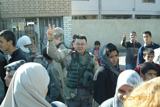 Chaplain Yan Xiong, in Iraq, in 2004. Xiong, now a captain in the U.S. Army, and stationed at the Warrant Officer Career College at Fort Rucker, Ala., was one of the students that took part in the protests at Tiananmen Square in 1989.