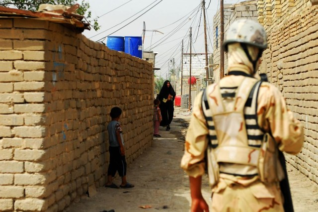 A soldier with the 14th Iraqi Army Division, 52nd Brigade maintains security outside of homes in the village of al-Tanuma during a search operation, dubbed Operation Carpet Ride, which aimed to capture illegal weapons and bomb making materials, May 29, 2010.