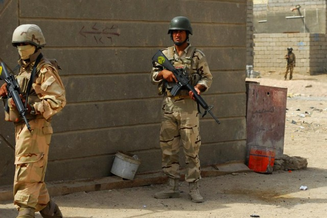 Soldiers with the 14th Iraqi Army Division, 52nd Brigade maintain security outside of homes in the village of al-Tanuma during a search operation, dubbed Operation Carpet Ride, which aimed to capture illegal weapons and bomb-making materials, May 29, 2010.