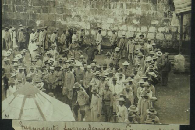 Surrender!  Insurgents Surrendering in Luzon, 1900 (Heller Collection).