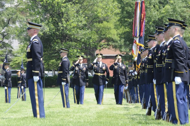 From left, Lt. Col. Brandon Robbins, incoming commander of 1st Battalion, Col. David Anders, Regimental Commander and Lt. Col. Robert Forte, outgoing battalion commander salute the colors during the pass in review portion of the change of command ceremony at Summerall Field on June 4.