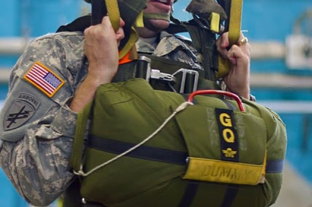 Master Sgt.  David S. Brunson with the U. S Army Civil Affairs and Psychological Operations Command (Airborne) task force, uses a British swing landing trainer which simulates being under the canopy of a low level parachute which British paratroopers use during their airborne operations. Brunson is one of over 90 USACAPOC(A) paratroopers from units across the U.S. who are participating in Operation Air Drop Normandy. The operation will commemorate the 66th Anniversary of D-day Allied Invasion by visiting key sites, participating in memorial ceremonies and conducting airborne operations on June 5, 2010 on the same drop zones their paratrooper brethren jumped on 66 years ago.