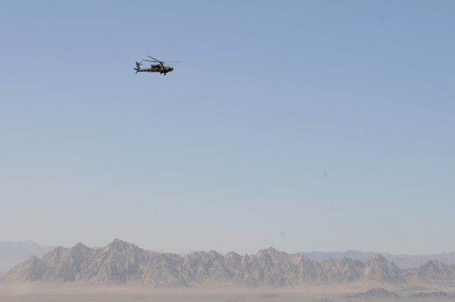 Capt. Ryan Murphy and Chief Warrant Officer 2 Jon Lauinger, 101st Combat Aviation Brigade, Task Force Destiny AH-64 Apache helicopter pilots fly over the mountains of Afghanistan May 28, 2010.