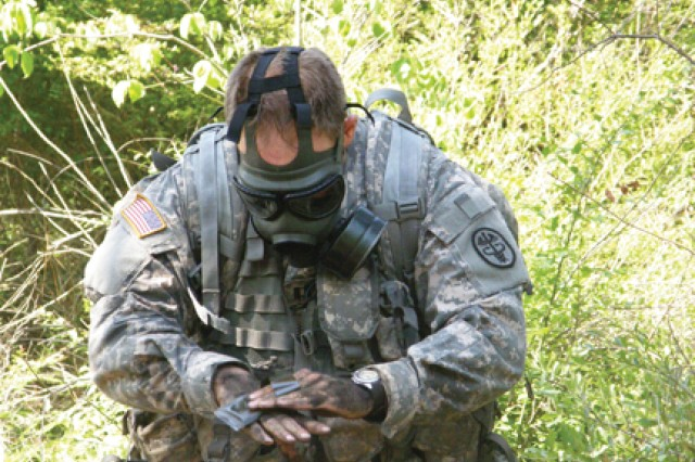 This 115th Combat Support Hospital Soldier decontaminates his skin during a scenario with deadly gas on a combat training lane May 25. The lane was a requirement to earn the Expert Field Medical Badge. There were 109 candidates that trained and tested for the EFMB in May.