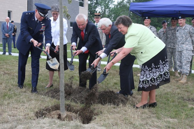 A commemorative tree is planted June 5 near the readiness center in Winchester, Va., by Maj. Gen. Robert B. Newman Jr., the adjutant general of Virginia, former Secretary of the Army John O. Marsh Jr., and relatives of  Maj. Thomas D. Howie who commanded the Winchester-base 3rd Battalion, 116th Infantry at D-Day and was killed in action while his unit was trying to capture the French town of Saint Lo.
