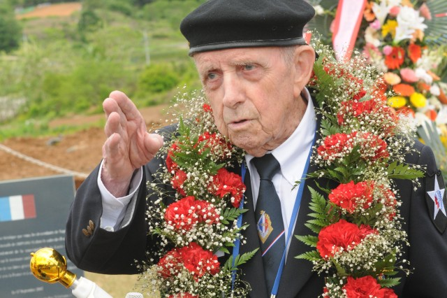 Retired French Army Col. Jacques Bouttin, who served as a junior officer in the Battle of Chipyong-ni, gestures toward the battle positions he and his Soldiers held nearly 60 years ago, during a reenactment of the battle, May 26, 2010.