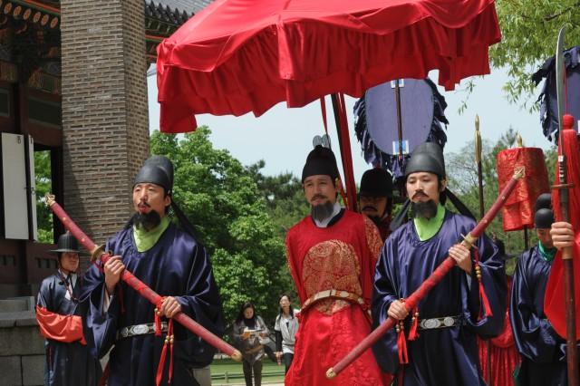 A simulation of a royal procession moves through Gyeongbok Palace in Seoul May 27.