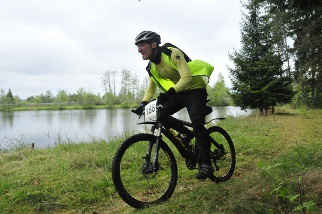 GRAFENWOEHR, Germany - Jay Danna cruises passed a rural lake on the scenic bicycle course during the 24 kilometer race.