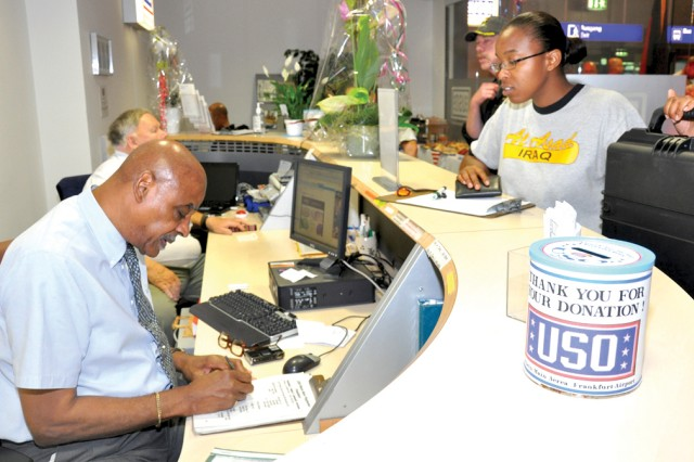 USO stalwart Earl Black and USO volunteer Helmut Esser help patrons at the new Frankfurt Airport USO Center.