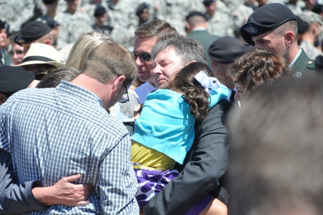 FORT CARSON, Colo.---Family members of the fallen Soldiers console each other at the conclusion of the Mountain Post Warrior Memorial ceremony May 27.