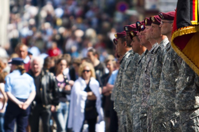 Paratroopers from the U.S. Army Civil Affairs and Psychological Operations Command (Airborne) stand in formation in St. Mere Eglise on the 66th Anniversary of D-Day Allied Invasion on June 6, 2010. USACAPOC(A) commemorated the event all week with remembrance ceremonies, tours of key battlegrounds, and airborne operations over the very drop zones American Soldiers landed on 66 years ago.