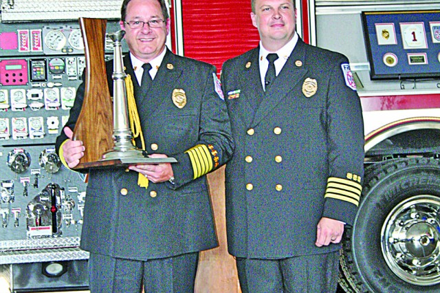 Outgoing Fort Riley Fire Department Chief Mike Cook and incoming chief Scott DeLay pose for a photo May 25 during Cook's retirement reception at Fort Riley Fire Station 1. DeLay will take over as fire chief June 6.