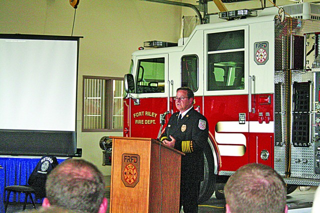 Fort Riley Fire Department Chief Mike Cook speaks to a full house May 25 during his retirement reception. Cook retired after 33 years of service as a firefighter.