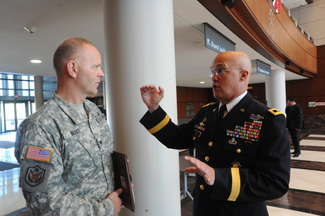 Maj. Gen. Karl R. Horst, commander of Joint Force Headquarters and The U.S. Army Military District of Washington and Col. Jerry L. Blixt, Garrison Commander, Ft. Belvoir talk in the lobby of the Fairfax Government Center after the presentation of the proclamation.