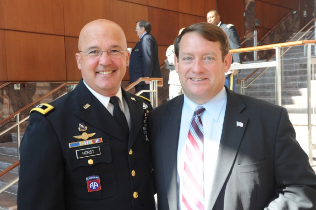 "Maj. Gen. Karl R. Horst, commander of Joint Force Headquarters and The U.S. Army Military District of Washington and Patrick S. ""Pat"" Herrity, a member of the Fairfax County Board of Supervisors, representing the Springfield District, stop to take a photo before the presentation of the Army Birthday proclamation at the reception in the Government Center Forum on June 8, 2010."
