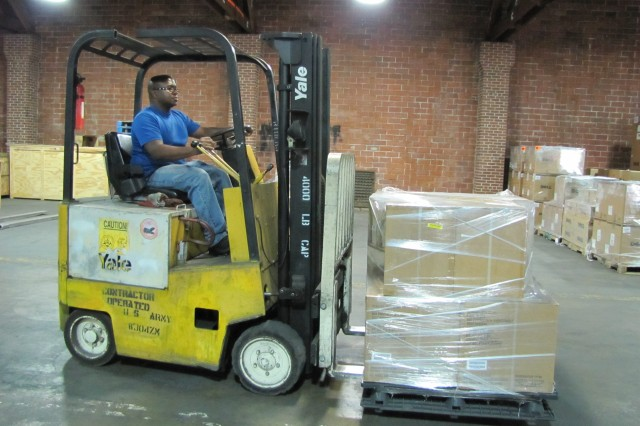 Forklift operator Jerry Brown moves equipment into areas marked for delivery. Brown is one of about 30 employees, many contractors, who work in the Garrison's Central Receiving operations. Northrop Grumman has held the contract for Central Receiving since 1994.
