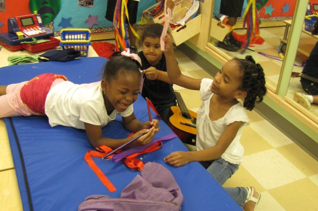 With puppets and props in hand, first-grader Keyanna Dees and kindergartners Morgan Hollingshed (background) and Jamya Green make up their own stories and fun. Drama and music will be part of the fun during Summer Blast Off at School Age Services.