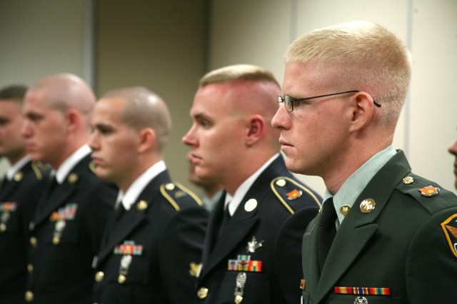 Candidates in the U.S. Army Space and Missile Defense Command/Army Forces Strategic Command Noncommissioned Officer/Soldier of the Year competition listen to instructions on the day of the boards June 7.