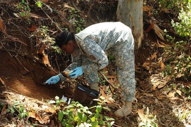 Second Lt. Jennifer Foreman, the environmental science officer of 225th Brigade Support Battalion, 2nd Bde. Combat Team, 25th Infantry Division, scoops a soil sample during environmental surveillance training at Lake Wilson, Wahiawa, Hawaii, May 27.  She will perform these missions in Iraq when her brigade deploys this summer.