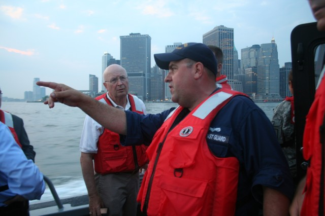 New York Naval Militia Petty Officer Kenneth Stephandel points out regions of New York City waterways patrolled by the Naval Militia's Military Emergency Boat Service to Minnesota Army National Guard Maj. Gen. Rick Nash of the 34th Infantry Division June 4.  Nash and other senior leaders of the Army National Guard's division headquarters came to New York City June 4-5 to discuss the future roles and missions of the Army National Guard combat divisions for homeland security and overseas contingency operations.  The maritime security assessment provided the Army Guard leaders with an overview of the complex terrain for homeland security missions in and around Manhattan since September 11, 2001.