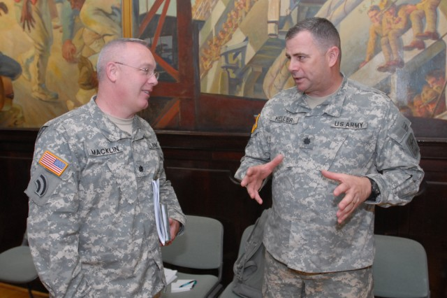 New York Army National Guard Lt. Col. Patrick Macklin, left, from the 42nd Infantry Division Headquarters Tactical Command Post, discusses the mission of the Domestic All-Hazards Response Team (DART) with National Guard Bureau current operations branch chief Lt. Col. Joseph Keller June 5 in New York City.  The two staff officers participated in the Army National Guard Division Commander's Conference, gathering all eight ARNG combat division commanders to review homeland security and overseas contingency missions.  Macklin will lead the 42nd Infantry Division DART mission cell over the next two fiscal years, providing a rapid response command and control element for states requesting additional National Guard forces.