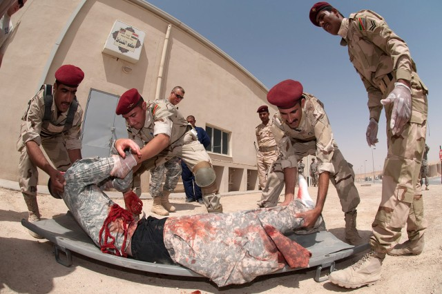 Iraqi medics with 7th Iraqi Army Division evacuate a simulated casualty during a mass-casualty training exercise near the dining facility of 7th IA Division headquarters June 3 at Camp Mejid. The simulated casualty is a paratrooper with 307th Brigade Support Battalion, 1st Advise and Assist Brigade, 82nd Airborne Division.