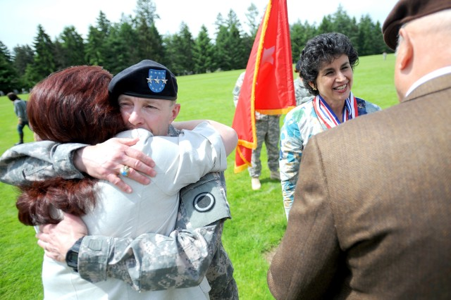 Lt. Gen. Charles H. Jacoby Jr., left, and his wife, Grace Jacoby, right, say their goodbyes to members of the Joint Base Lewis-McChord community after the I Corps Relinquishment of Command Ceremony, Tuesday. Jacoby handed over command to Maj. Gen. John D. Johnson.