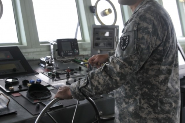 Chief Johnett Razon navigates the LCU-2005 Brandy Station which carried a 20-foot radar used to track the launch of the Atlantis Space Shuttle.