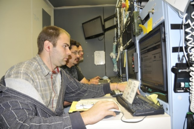 Doppler radar technicians Ben Lane, Tom Peabody, and Mario Perez, conduct calibrations and tests on the Weibel X-Band Doppler radar computer equipment prior to the launch of the Atlantis Space Shuttle.