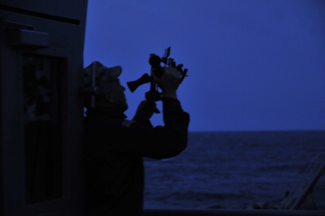 Warrant Officer Tom Heald, an Army Reserve Soldier, shoots a plot for the sun during the last few minutes of sunset as he learns Celestial Navigation with the Stars aboard the Army watercraft LSV-1. The LSV-1 is assigned to the 335th Transportation Company, 24th Transportation Battalion, 7th Sustainment Brigade.
