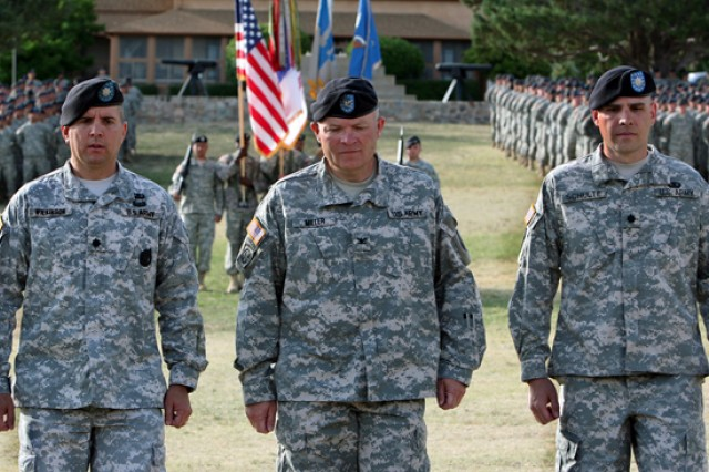 From left, outgoing Commander Lt. Col. Kevin Wilkinson, Col. Thomas Miller, ceremony reviewing officer and commander of the 111th Military Intelligence Brigade, and incoming 309th Military Intelligence Battalion Commander Lt. Col. Robert Schulte return to their seats after exchanging the battalion guidon, June 3, on Fort Huachuca's Brown Parade Field.