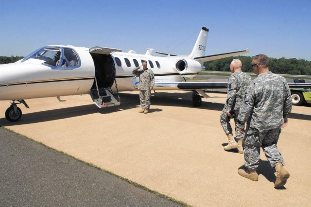 Maj. Gen. Raymond W. Carpenter, Acting Director, Army National Guard, National Guard Bureau, Washington, D.C., is escorted by Col. Michael Bobeck, commander of OSAA, to the UC-35 jet at Davison Army Airfield.