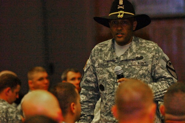 FORT HOOD, Texas - Command Sgt. Maj. James Norman, 1st BCT, 1st Cav. Div., talks to the division's newcomers about the traditions and standards of the division, June 8, at the Phantom Warrior Center.