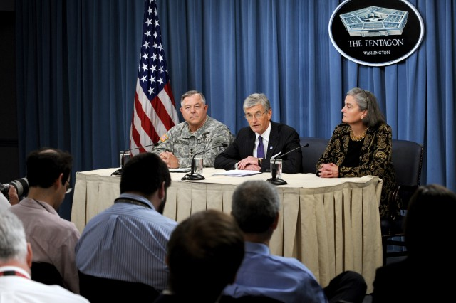 Secretary of the Army John M. McHugh (center) holds a press conference at the Pentagon, June 10, 2010, to announce changes in the leadership of Arlington National Cemetery resulting from an internal investigation into allegations of improprieties and mismanagement at the hallowed burial ground. McHugh told reporters that he had relieved the current superintendent and deputy superintendent of their duties and placed Kathryn Condon (right) in the position of Executive Director of the Army National Cemeteries Program. The investigation was conducted by Lt. Gen. R. Steven Whitcomb (left), the Army inspector general.