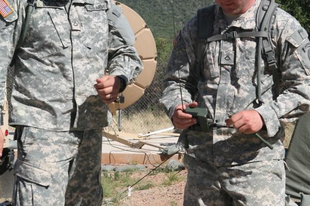Pfc. Jordan Burton and Pfc. Jason Roberts assemble an AN/PRD-13(V)2 Man-Portable Signals Intelligence System.
