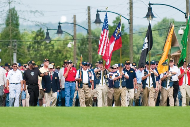 "A few hundred Vietnam War veterans move up from World War II Company Street onto the parade field June 5 during the ""Welcome Home"" ceremony at the National Infantry Museum and Soldier Center."