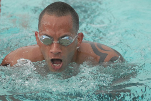 Raymond Santiago, of 4th Ranger Training Battalion, takes a breath as he rounds the final lap in the 550-meter swim.