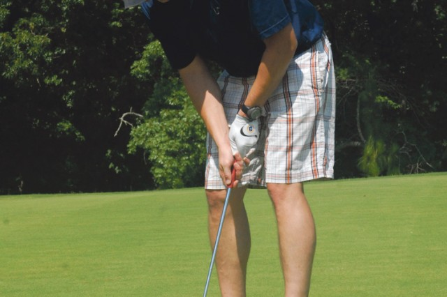 CPT Josh Peyton lines up a putt for par at No. 5 on the Patton Course during the June 8 scramble golf tournament.