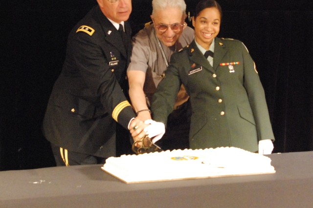 Pvt. 1st Class Melissa McBride, of Enterprise, Ala. helps Maj. Gen. Robert Williams, Army war College Commandant and Chaplain (Col.) D'Emma, cut the 235th Army Birthday cake, June 11 in Carlisle, Pa.