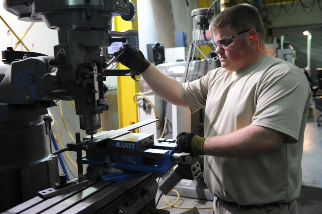 Anniston Army Depot machinist Dallas Cooper performs fabrication on a piece of equipment at the TACOM Life Cycle Management Command Forward Repair Activity in Kuwait.