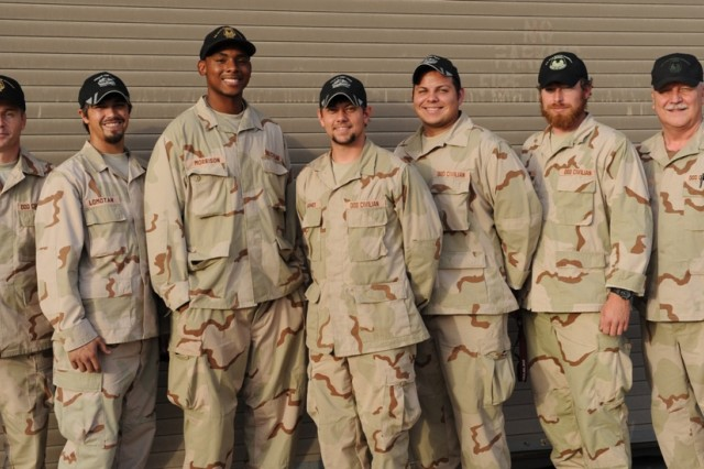 A few members of Anniston's team at the TACOM Life Cycle Management Command Forward Repair Activity in Kuwait endure the heat for a photo. They are Ted Ervin, David Lomotan, Phillip Morrison, Josh Hughes, Eli Careaga, Stephen Freeman and Gary