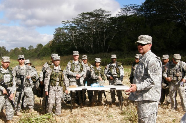 Director of the Counter IED Fusion Center with the U.S. Army, Pacific, Col. Stanley Toy briefs Soldiers at Asia-Pacific C-IED Capabilities Training.