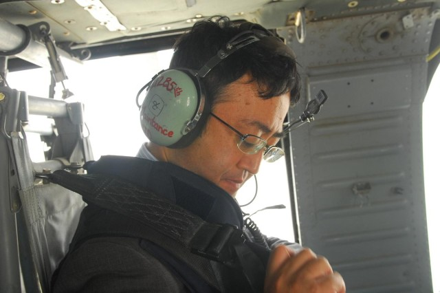 Japanese Charge D'Affaires Katsuhiko Takahashi straps himself in before flying to the remote Rumaila oil field. Takahashi was part of an international delegation touring the site to gather information on the potential of Iraq's oil industry.