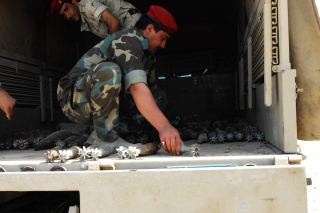 Soldiers with the 1st Bomb Disposal Company, 14th Iraqi Army Division, load and secure munitions during their preparation for a controlled detonation at the Normandy Range in Basra, Iraq.