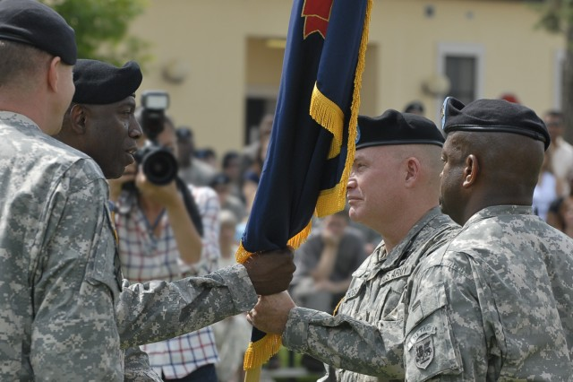 VICENZA, Italy - Gen. William E. Ward, commanding general of U.S. Africa Command (second from left), passes the U.S. Army Africa colors to Maj. Gen. David R. Hogg, as he accepts command of U.S. Army Africa. Command Sgt. Maj. Gary Bronson, U.S. Army Africa's senior enlisted leader and outgoing commander Maj. Gen. William B. Garrett III, look on. Hundreds of Soldiers, U.S. Army civilians and Italian leaders gathered during the June 10 ceremony at Caserma Ederle's Hoekstra Field.