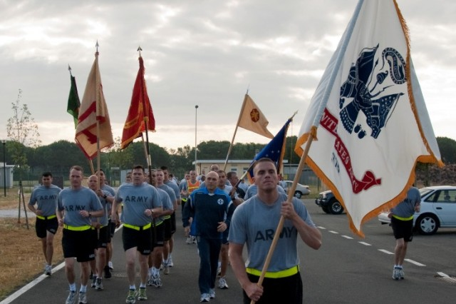 The Army flag leads the way of during the Camp Darby Army Birthday fun run June 14.
