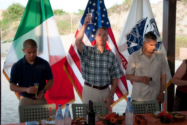 (Center) Lt. Col. Kevin Bigelman, U.S. Army Garrison Livorno commander, proposes a salute to the Commander in Chief during the Camp Darby Army Birthday celebration. The celebration took place at the American Beach in Tirrenia June 12.
